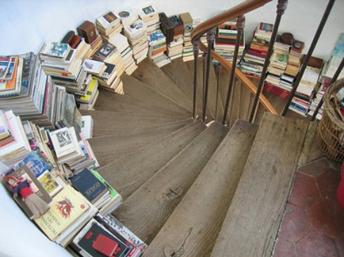 Books Stacked on Stairs