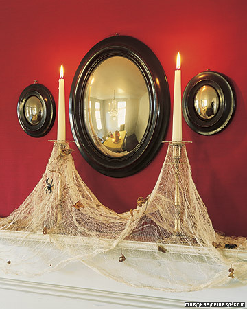 cheesecloth spiderwebs on candles halloween martha stewart