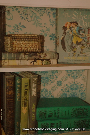 vintage wallpapered cabinet