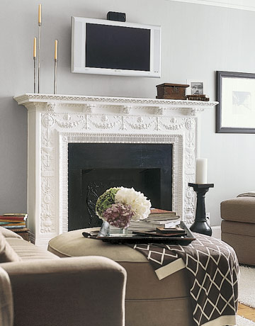 Decorating around the television the decorologist for Decor over fireplace