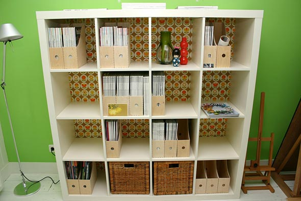 source adding baskets and cubes makes ikeas expedit bookcases - Ikea Bookshelves Expedit