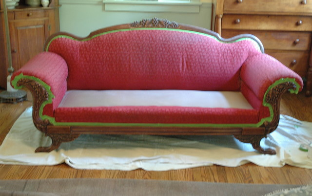 red upholstery painted wood