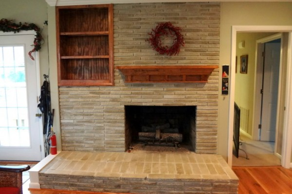 The solution to the dated brick fireplace that even your for Fireplace paint color ideas