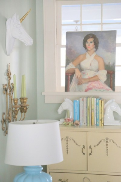 vintage portraits in designer living room