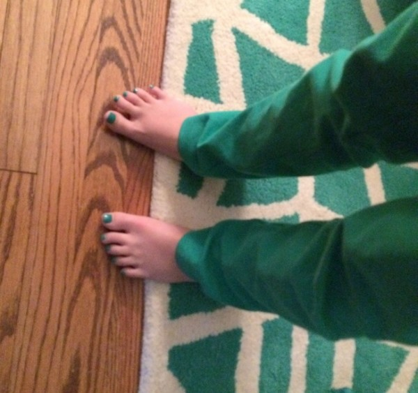 green toenails and rug