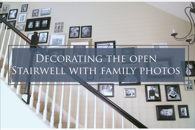 hanging family photos in stairwell