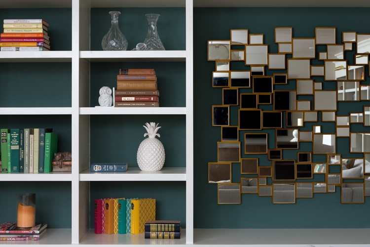white bookcase with spinach green paint and gold accents
