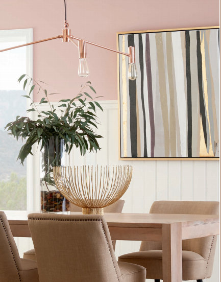 dining room with pink sherwin williams wall color and gold accents