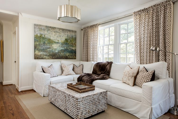 white sectional staged living room by the decorologist