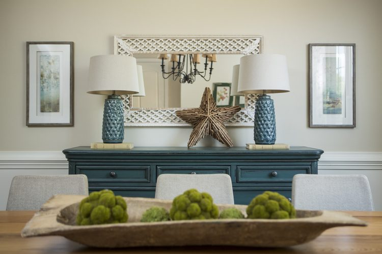 home staging training with The Decorologist, blue sideboard with pair of blue ceramic lamps, dough bowl with moss balls on transitional dining table