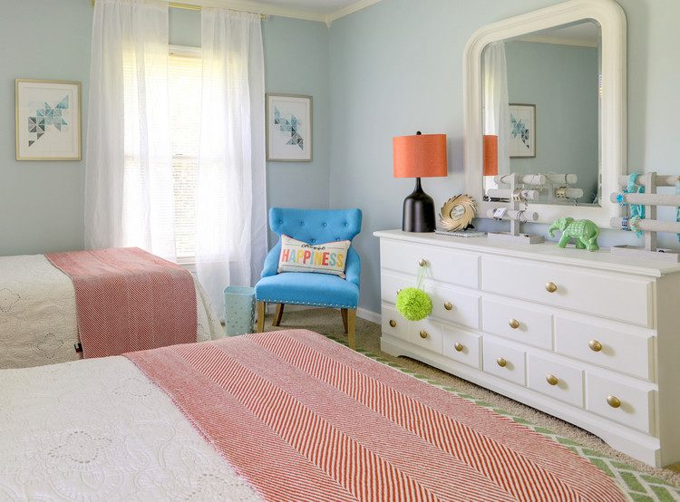white painted dresser and blue tufted chair in teen room with Sherwin Williams Tradewind paint color