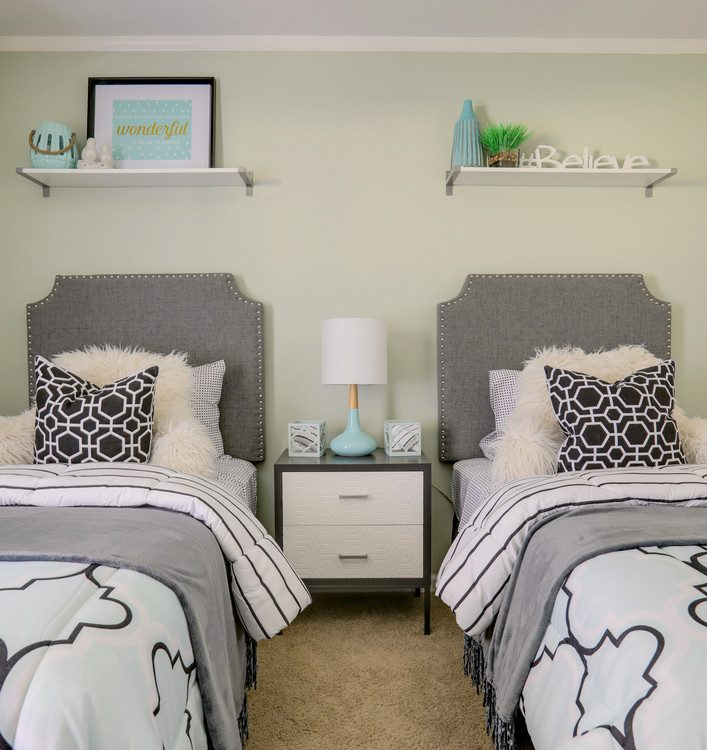 SW Frostwork girls bedroom paint color on walls with gray headboards and black and gray bedding