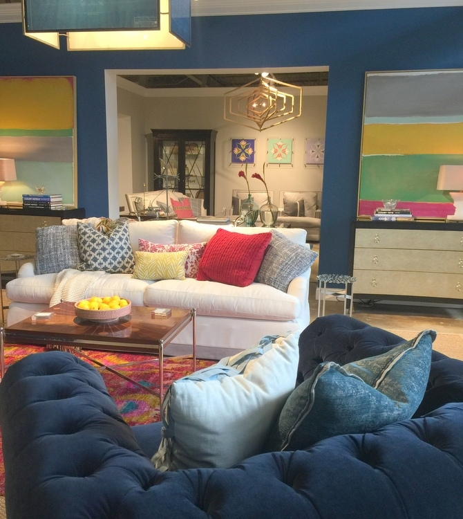 Universal Furniture showroom featuring royal blue sofa and walls