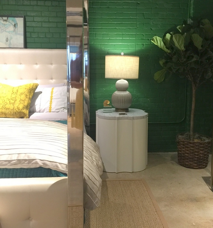 emerald green wall in universal furniture showroom