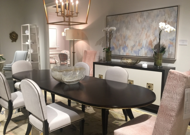 Highland House dining room in High Point Furniture Market showroom with pink upholstered chairs and white chairs