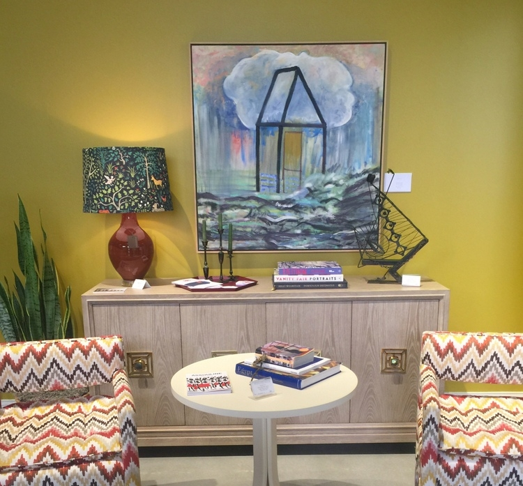 mustard yellow walls at highland house showroom at high point market