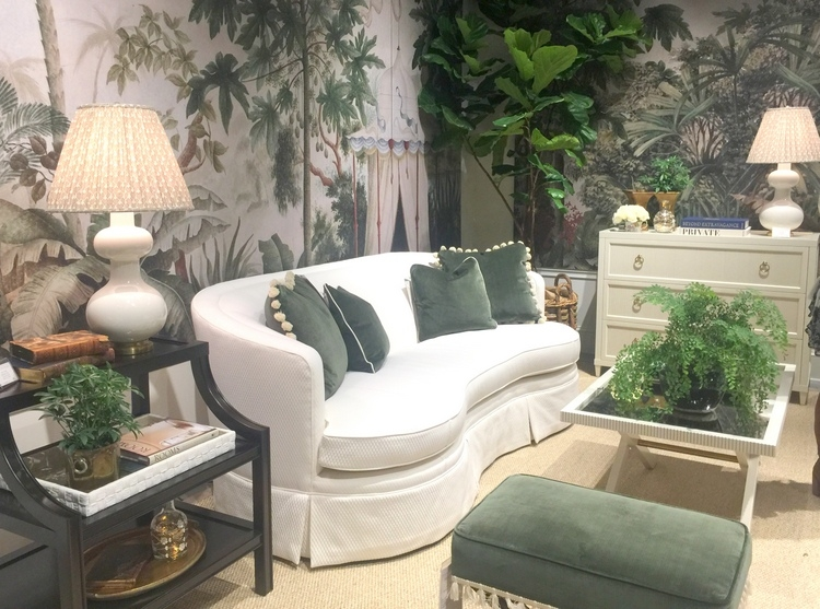 white sofa, green leaf wallpaper, forest green pillows and upholstery at Highland House furniture showroom