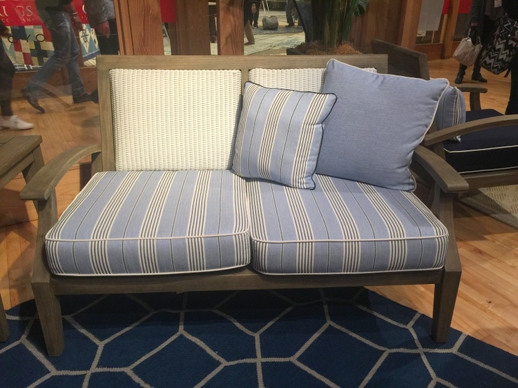 lloyd flanders outdoor furniture showroom with blue and white upholstered bench