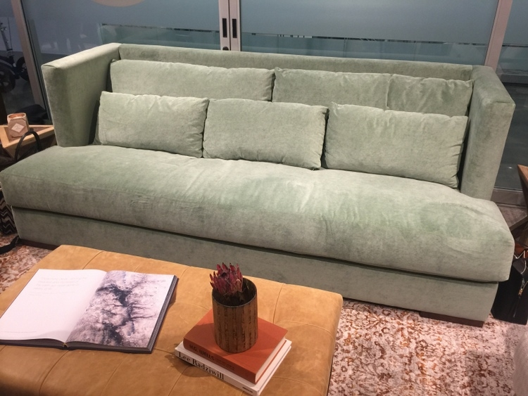 mint green sofa in Younger Furniture showroom at High Point Furniture Market
