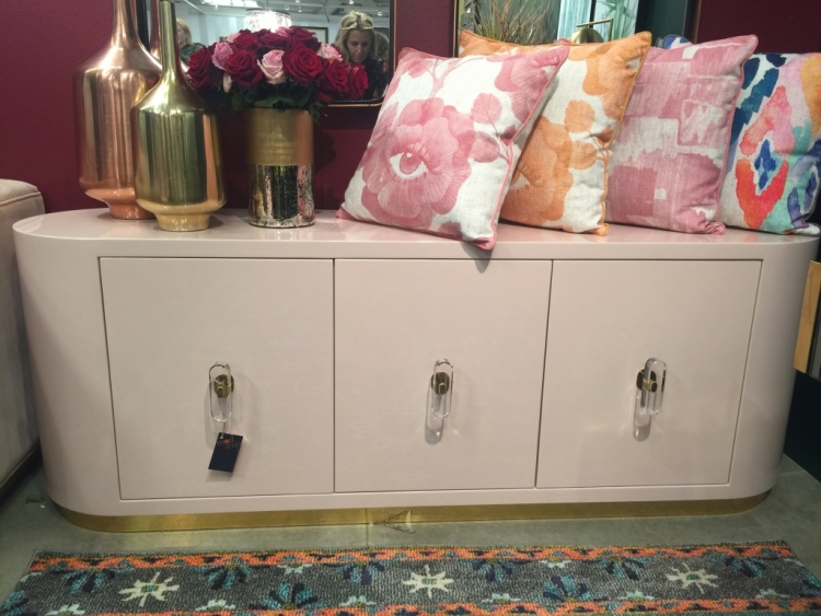 pink credenza with lucite handles in ModShop showroom at High Point Market
