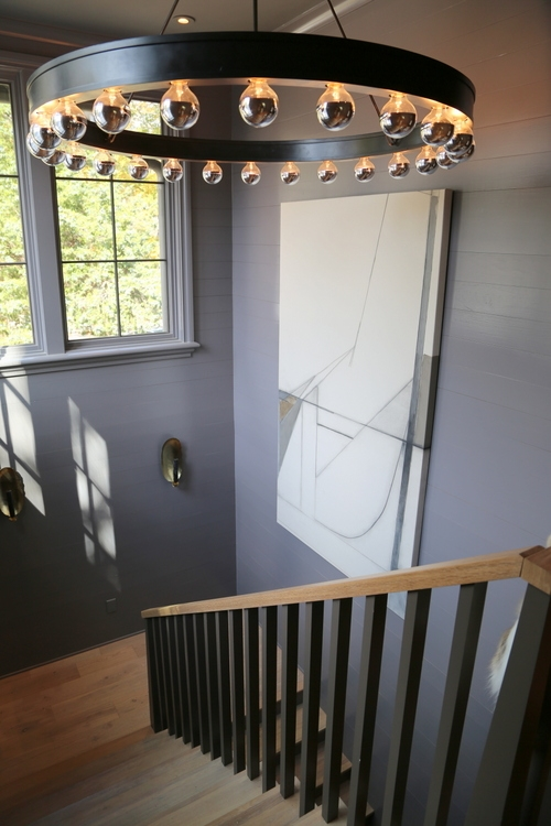 dark gray stairwell shiplap in omore designer showhouse