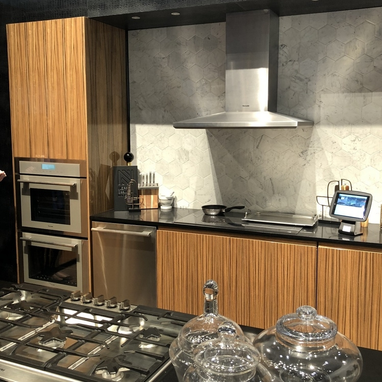 tiger wood kitchen cabinets from Thermador booth at 2018 KBIS