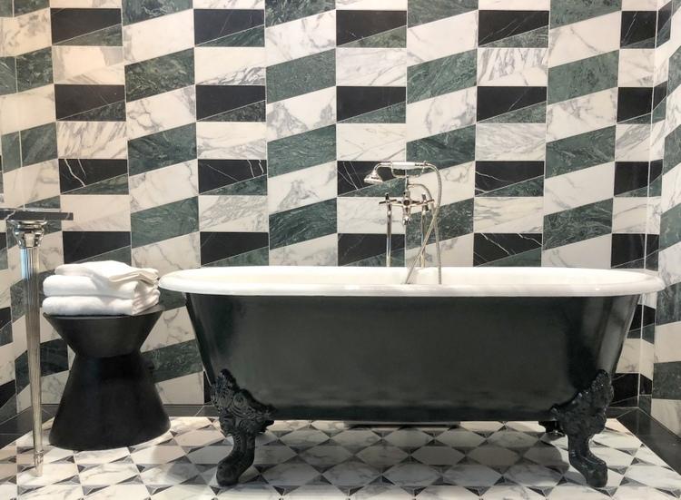green bathroom with kelly wearstler ann sacks tile and green clawfoot tub at 2018 KBIS