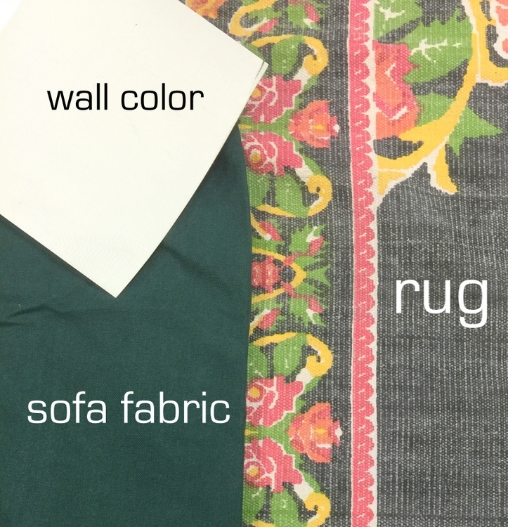 matching colors of a rug with wall and sofa colors