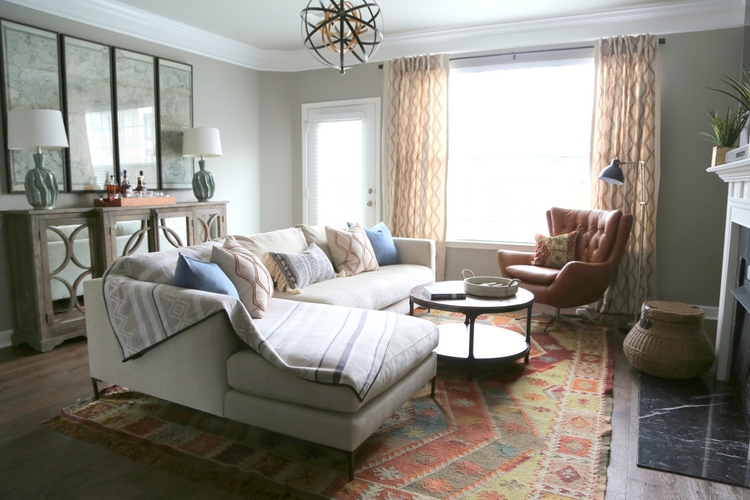 pottery barn sectional sofa and kilim rug in masculine living room interior design by the decorologist