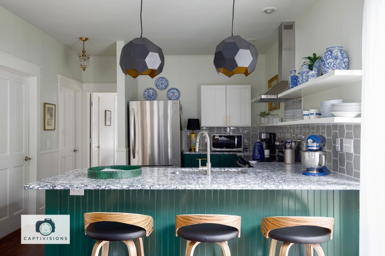 33 Palms Kitchen, designed by Kristie Barnett, The Decorologist, green base cabinets, Rose Bay Cambria quartz