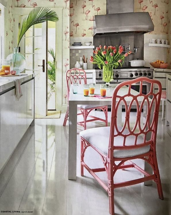 Mary McGee kitchen design with flamingo wallpaper and hot pink rattan chairs