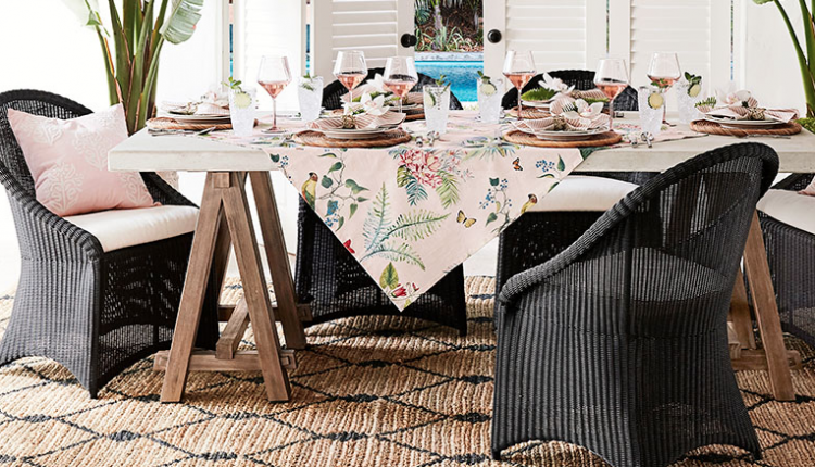 pink floral tablecloth and charcoal wicker chairs