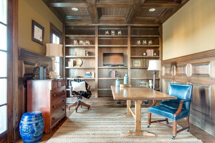 staged office with wood paneling and coffered ceiling