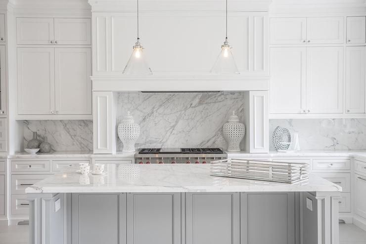 statuary marble countertops and backsplash in white kitchen
