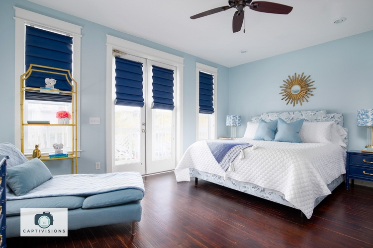 designer bedroom wall color is SW6218 Tradewind by Sherwin-Williams, design by Kristie Barnett, The Decorologist