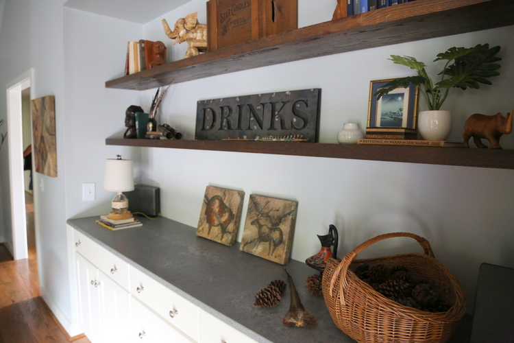 stained wood open shelving and concrete-look quartz countertop