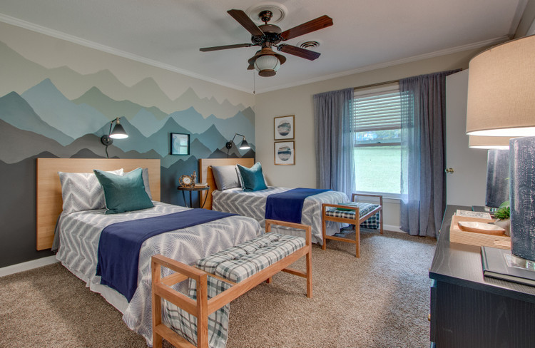 outdoor lodge themed boys guest bedroom with mountain range mural by the decorologist