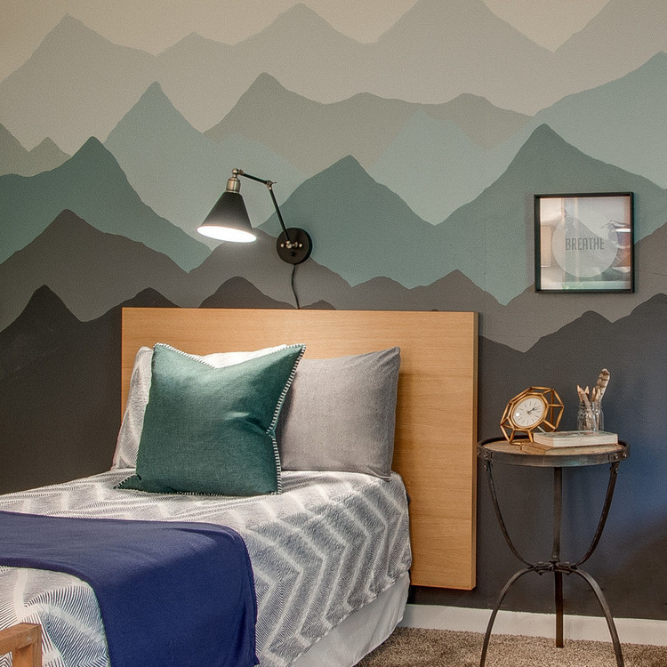 wood headboard and mountain wall mural