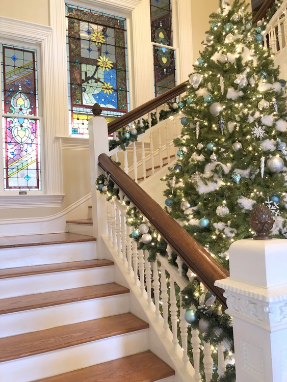 stained glass windows in staircase of historic home