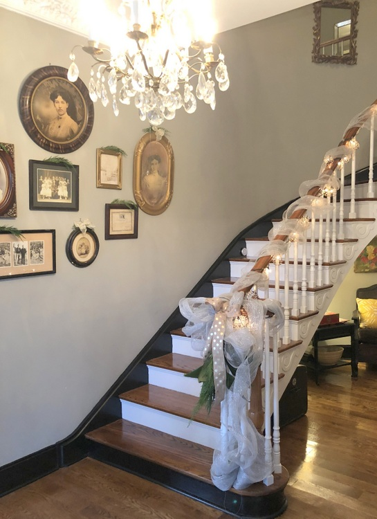 curved staircase in historic home with black base molding