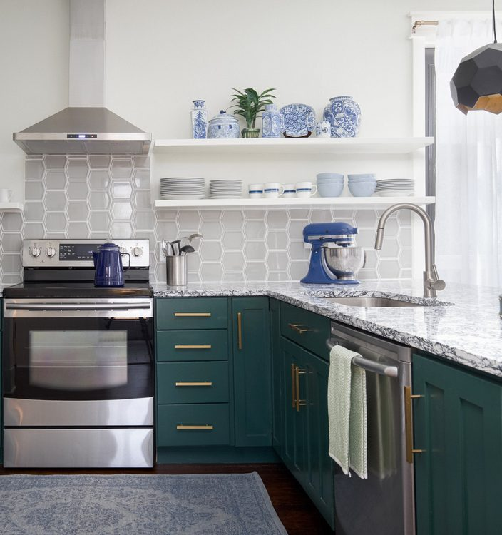 green lower cabinets and open shelving in kitchen design by The Decorologist