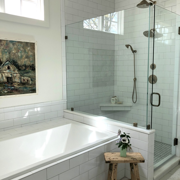 glass shower enclosure, soaking tub, and subway tile continue to be 2019 decorating trends