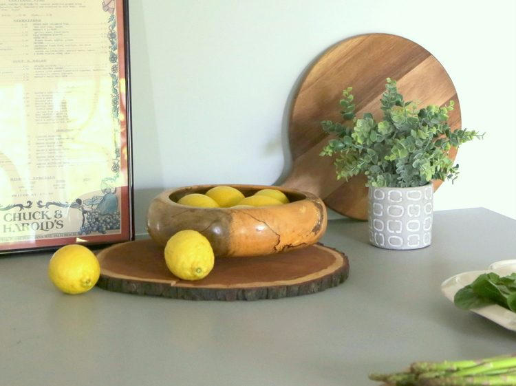 wooden bowls and cutting boards in kitchen photo styling