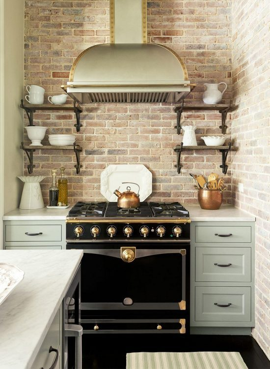 statement stove with brick wall and white ironstone kitchen photo styling