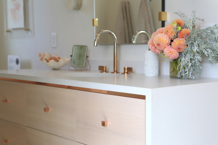 blush bathroom cabinet and rose gold fixtures