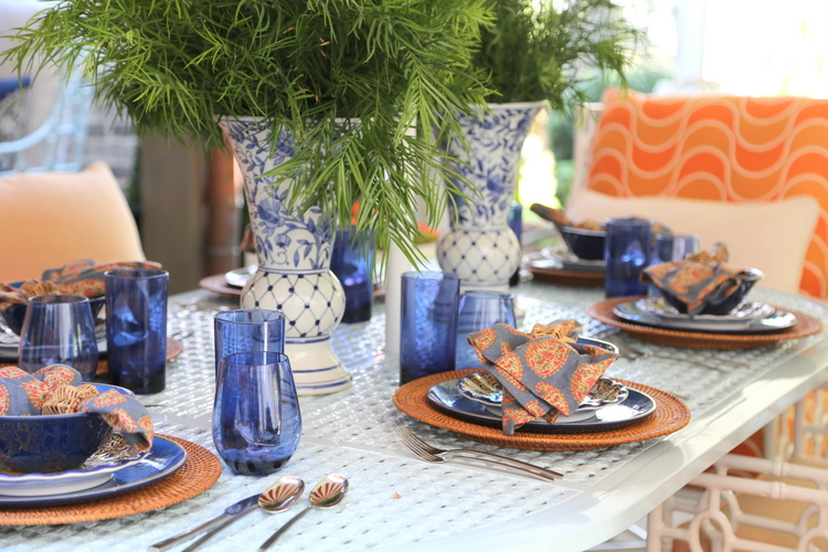 orange and blue outdoor tablesetting