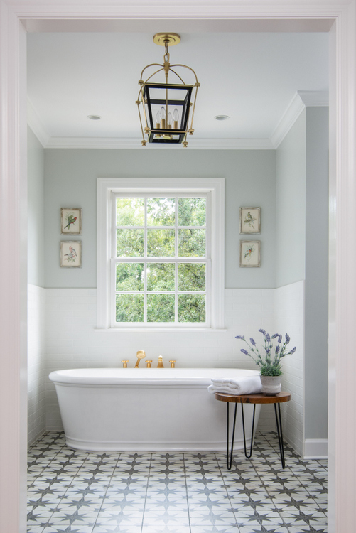 free standing tub in classic bathroom by The Decorologist