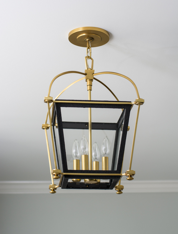 iron and gold light fixture