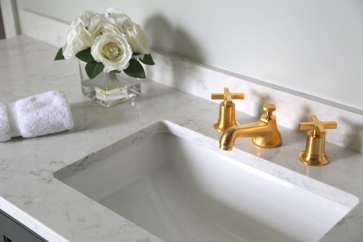 gold faucets in bathroom design by Kristie Barnett