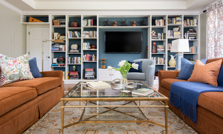 television in bookcase with dark blue in the background, a room with multiple focal points